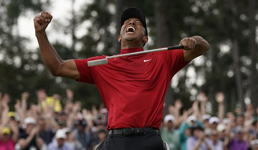 Tiger Woods reacts as he wins the Masters golf tournament Sunday, April 14, 2019, in Augusta, Ga. (AP Photo/David J. Phillip) ** FILE **
