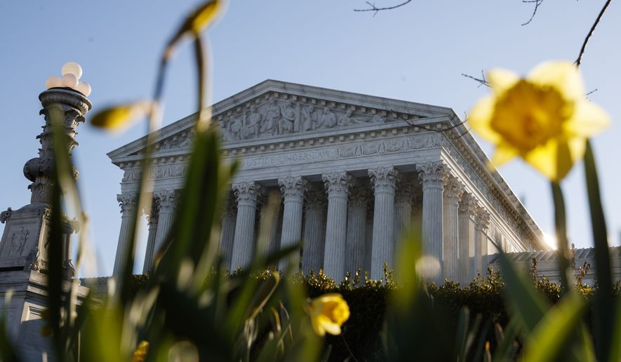 The Supreme Court building is seen on Capitol Hill in Washington, Tuesday, March 26, 2019. The Supreme Court is returning to arguments over whether the political task of redistricting can be overly partisan. (AP Photo/Carolyn Kaster)