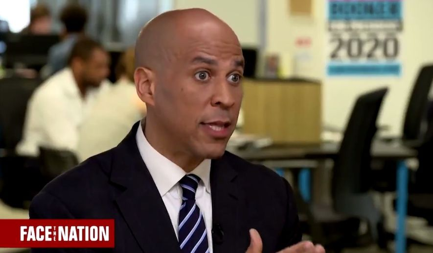 "Sen. Cory Booker speaks with Margaret Brennan of CBS News' ""Face the Nation,"" April 13, 2019. The New Jersey Democrat says President Trump aims to make the U.S. ""less safe"" by sending migrants to sanctuary cities. (Image: Twitter, ""Face the Nation"" video screenshot)"