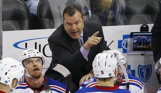 In this Nov. 2016, file photo, New York Rangers head coach Alain Vigneault, top, gives instructions in the third period of an NHL hockey game against the Pittsburgh Penguins in Pittsburgh. The Philadelphia Flyers have hired Vigneault as head coach. Vigneault has led the Rangers and Vancouver Canucks to the Stanley Cup final and takes over a Flyers team that missed the playoffs for the second time in three seasons. (AP Photo/Gene J. Puskar, File) **FILE**