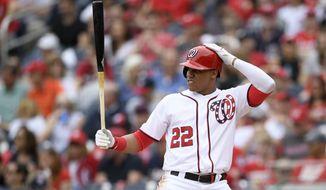 Washington Nationals' Juan Soto bats during a baseball game against the Pittsburgh Pirates, Sunday, April 14, 2019, in Washington. (AP Photo/Nick Wass)