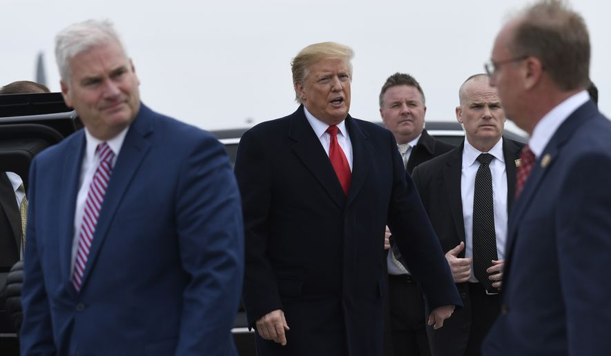 President Donald Trump, center, walks to his car after arriving at Minneapolis-Saint Paul Air Reserve Station in Minneapolis, Monday, April 15, 2019.  (AP Photo/Susan Walsh)