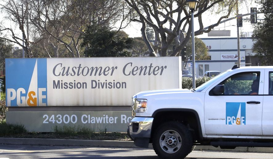 FILE- In this Jan. 23, 2019, file photo a Pacific Gas & Electric truck enters their customer center in Hayward, Calif. California regulators expressed skepticism that Pacific Gas & Electric's new board of directors and chief executive have enough professional experience to instill a deep corporate culture of safety at a utility blamed for more than a dozen of the state's most destructive wildfires over the last two years. California Public Utilities Commission president Michael Picker said Monday, April 15, 2019, regulators question whether PG&E is properly addressing its many problems, including its bankruptcy filing. (AP Photo/Ben Margot, File)