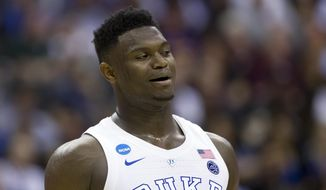 In this March 29, 2019, file photo, Duke forward Zion Williamson (1) reacts during an East Regional semifinal in the NCAA men's basketball tournamenet against Virginia Tech in Washington. Williamson was named the John R. Wooden Men's Player of the year at the College Basketball Awards ceremony in Los Angeles on Friday, April 12, 2019. (AP Photo/Alex Brandon, File) **FILE**