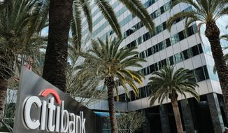 FILE- This March 23, 2018, file photo shows the entrance to Citibank at the Citigroup Center in downtown Los Angeles. Citigroup reports earnings Monday, April 15, 2019. (AP Photo/Richard Vogel, File)