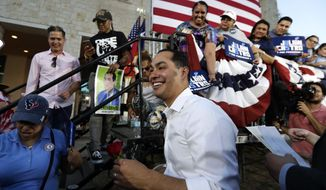 Julian Castro, a 2020 Democratic presidential candidate, greets supporters during a rally in San Antonio, Wednesday, April 10, 2019. (AP Photo/Eric Gay)