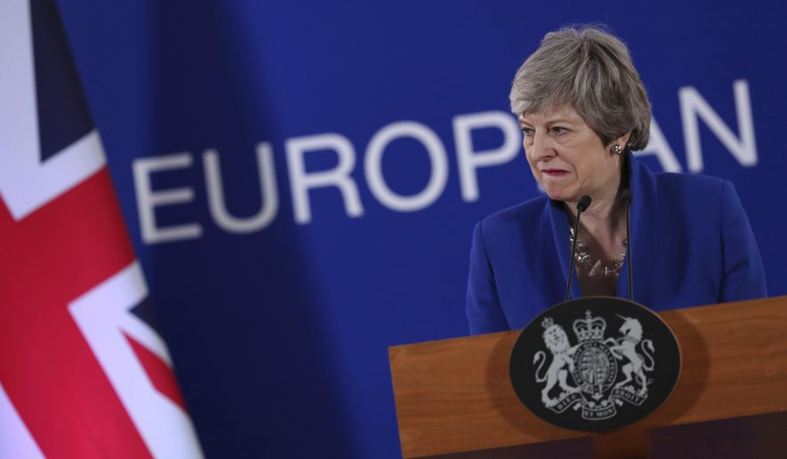 FILE - In this Thursday, April 11, 2019 file photo, British Prime Minister Theresa May speaks during a media conference at the conclusion of an EU summit in Brussels. May's Downing St. office says the prime minister and her husband Philip started a short walking holiday in Wales on Saturday, April 14. Parliament is on an Easter break, after months of bruising battles in Parliament over Brexit that saw May's European Union divorce deal rejected by lawmakers three times. (AP Photo/Francisco Seco, file)