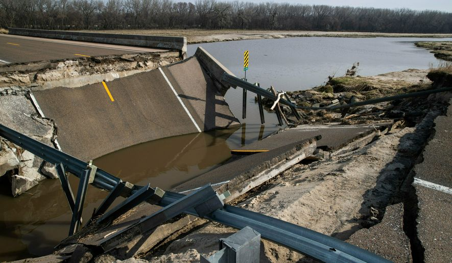 A bridge destroyed by floodwaters on Highway 39 is shown Friday, April 5, 2019, near Silver Creek, Neb. The damage is preventing students from reaching Silver Creek High School. (Brendan Sullivan/Omaha World-Herald via AP)