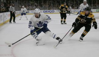 Toronto Maple Leafs right wing William Nylander (29) controls the puck ahead of Boston Bruins defenseman Matt Grzelcyk (48) during the first period of Game 2 of an NHL hockey first-round playoff series, Saturday, April 13, 2019, in Boston. (AP Photo/Mary Schwalm)