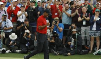 Tiger Woods reacts as he wins the Masters golf tournament Sunday, April 14, 2019, in Augusta, Ga. (AP Photo/Matt Slocum) ** FILE **