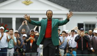 Tiger Woods smiles as he wears his green jacket after winning the Masters golf tournament Sunday, April 14, 2019, in Augusta, Ga. (AP Photo/Matt Slocum) **FILE**