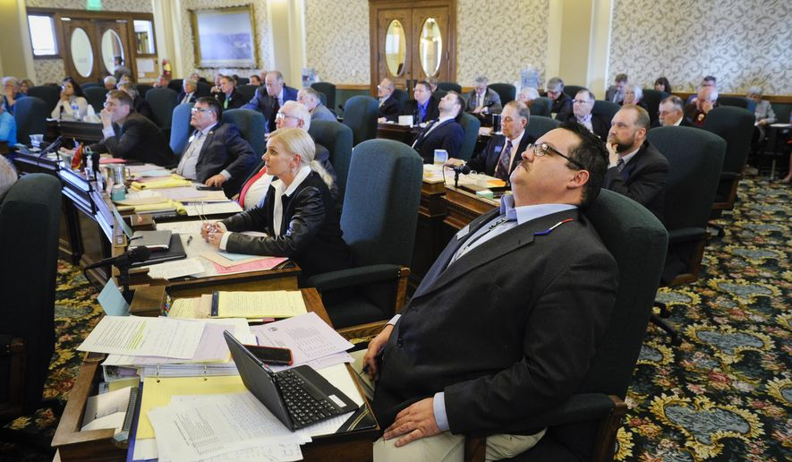Sen. Jason Small, R-Busby, who is carrying the Medicaid expansion bill in the Senate watches as the Senate gives its initial endorsement of the bill in Helena, Mont., Monday, April 15, 2019. The Montana Senate on Monday narrowly endorsed a bill to continue the state's Medicaid expansion program. The vote came a day before a deadline to send the bill to the state House.(Thom Bridge/Independent Record via AP)