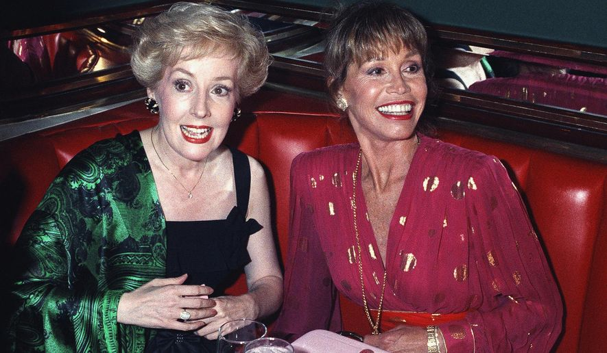"FILE - In this Aug. 30, 1992, file photo, Mary Tyler Moore, right, is joined by former ""Mary Tyler Moore Show"" co-star Georgia Engel,  left, who played Georgette, at New York's Russian Tea Room, as the two reunited during an Emmy Awards screening party Moore hosted at the famous New York restaurant. Engel died Friday, April 12, 2019, in Princeton, N.J., at age 70. (AP Photo/Malcolm Clarke, File)"