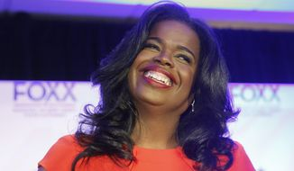 FILE--In this March 15, 2016, file photo, Kim Foxx smiles at the crowd as she celebrates her primary win over incumbent Democratic Cook County State's Attorney Anita Alvarez in Chicago. Foxx, now the Cook County State's Attorney, says she hopes to begin expunging minor cannabis convictions in the coming months but acknowledges it won't be easy to implement her plan and that her office is still figuring out its scope. Foxx told the Chicago Sun-Times last week that she estimates that thousands of misdemeanor drug convictions could be wiped out. Foxx says her office is also reviewing its policy toward prosecuting those detained for selling marijuana. (AP Photo/Charles Rex Arbogast, File)