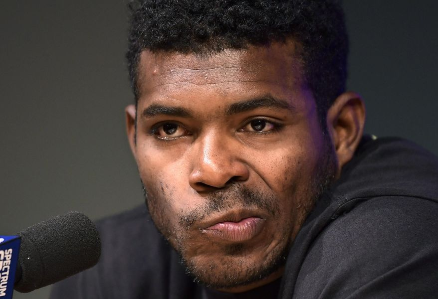 Cincinnati Reds' Yasiel Puig speaks to reporters prior to a baseball game against the Los Angeles Dodgers, Monday, April 15, 2019, in Los Angeles. (AP Photo/Mark J. Terrill)