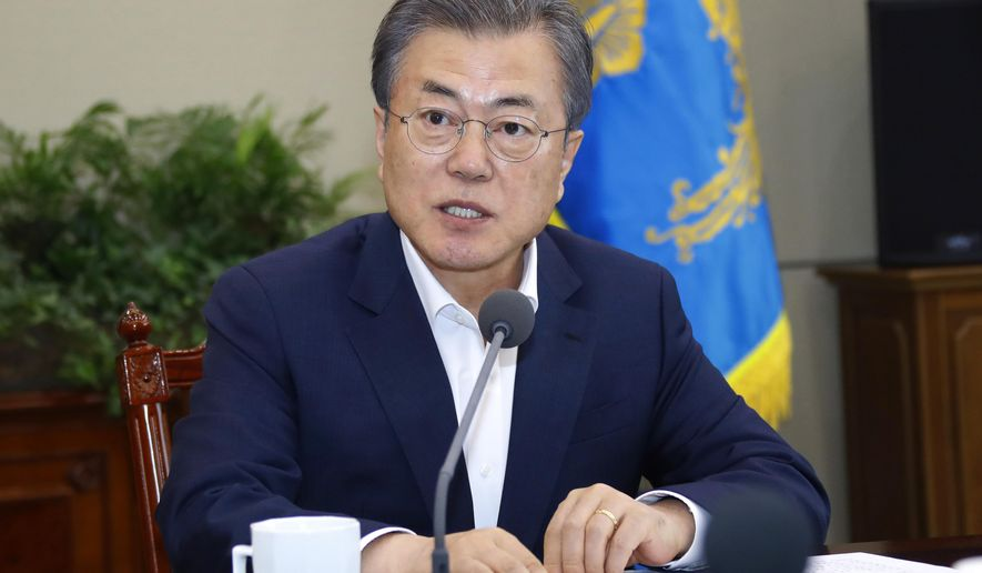 South Korean President Moon Jae-in speaks during a meeting with his aids at the presidential Blue House in Seoul, South Korea, Monday, April 15, 2019. Moon says he's ready for a fourth summit with North Korean leader Kim Jong Un to help salvage faltering nuclear negotiations between Washington and Pyongyang. (Bee Jae-man/Yonhap via AP)