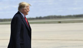President Donald Trump walks towards the steps of Air Force One at Andrews Air Force Base in Md., Monday, April 15, 2019. Trump is heading to Minnesota for a tax day event. (AP Photo/Susan Walsh)