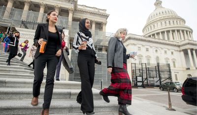 Rep. Ilhan Omar, Minnesota Democrat, (second from left), reported collecting over $832,000 for her campaign. This puts her ahead of Rep. Alexandria Ocasio-Cortez, (left), and other prominent lawmakers. In 2018, Ms. Omar won her congressional race with 78% of the vote. (Associated Press)