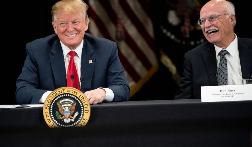 President Donald J. Trump spoke at Nuss Truck and Equipment in Burnsville during a roundtable discussion on tax cuts and the U.S. economy in Burnsville, Minn., on Monday, April 15, 2019. At right is the president of Nuss Truck and Equipment Bob Nuss. (Renee Jones Schneider/Star Tribune via AP)