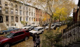 FILE - In this Nov. 7, 2018, file photo, fallen leaves cover cars and sidewalks on a tree-lined residential block in Long Island City in the Queens borough of New York. How your parents prepare for retirement, long-term care and estate planning can affect your own financial future. Talking to them now can save your family headaches and messy conversations down the road. (AP Photo/Mark Lennihan, File)
