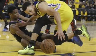 Los Angeles Clippers guard Shai Gilgeous-Alexander, left, and Golden State Warriors guard Stephen Curry reach for the ball during the second half of Game 2 of a first-round NBA basketball playoff series in Oakland, Calif., Monday, April 15, 2019. (AP Photo/Jeff Chiu)