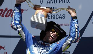 CORRECTS TO RINS OF SPAIN NOT AUSTRALIA = Alex Rins, of Spain, celebrates with his trophy after winning the Grand Prix of the Americas motorcycle race at the Circuit of the Americas, Sunday, April 14, 2019, in Austin, Texas. (AP Photo/Eric Gay)