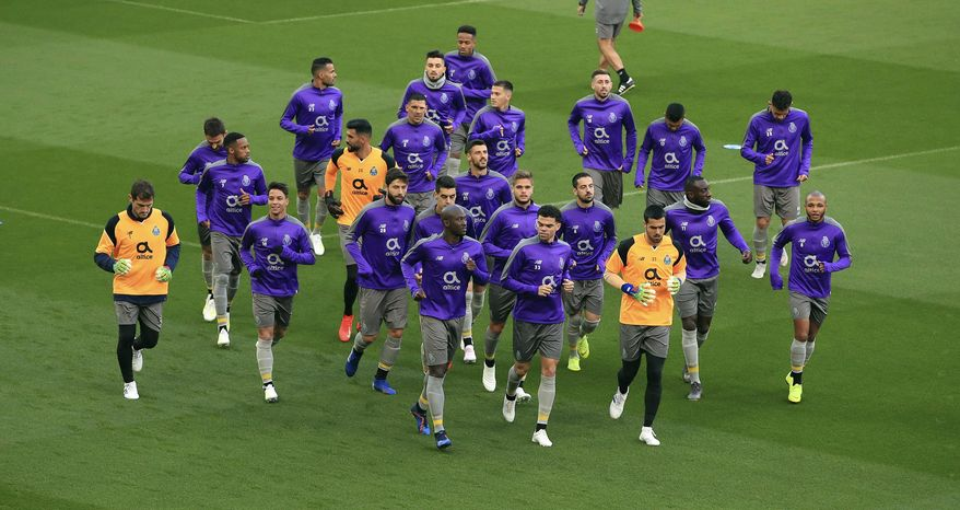 Porto's Danilo Pereira, front left, Pepe, front right, and Iker Casillas, far left, attend a training session at Anfield, Liverpool, England, Monday, April 8, 2019. Porto will play Liverpool in a Champions League quarter final soccer match on Tuesday. (Peter Byrne/PA via AP)