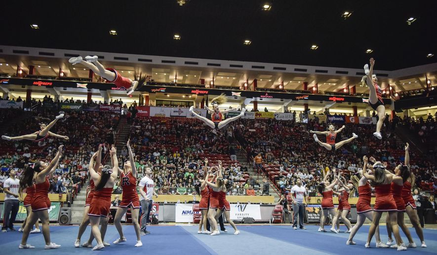 This 2018 photo shows competition at the New Mexico State Spirit Championships at The Pit in Albuquerque, N.M. The 2020 statewide high school cheerleading and dance competition may be terminated thanks to a rash of terrible sportsmanship. (Roberto E. Rosales/The Albuquerque Journal via AP)