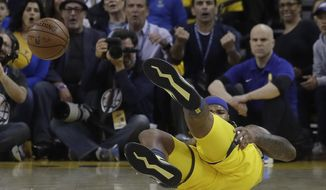 Golden State Warriors center DeMarcus Cousins reacts after falling to the floor during the first half of Game 2 of a first-round NBA basketball playoff series against the Los Angeles Clippers in Oakland, Calif., Monday, April 15, 2019. (AP Photo/Jeff Chiu) ** FILE **