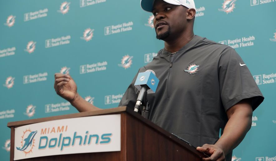 Miami Dolphins head coach Brian Flores speaks at a news conference during voluntary minicamp at the Miami Dolphins NFL football training facility, Tuesday, April 16, 2019, in Davie, Fla. (AP Photo/Lynne Sladky)