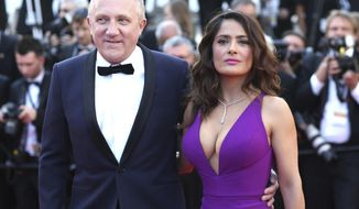 """FILE - In this Sunday, May 17, 2015 file photo Francois-Henri Pinault and Salma Hayek pose for photographers upon arrival for the screening of the film Carol at the 68th international film festival, Cannes, southern France. Businessman Francois-Henri Pinault and his billionaire father Francois Pinault said they were immediately giving 100 million euros from their company, Artemis, to help finance repairs to fire damaged Notre Dame cathedral. A statement from Francois-Henri Pinault said """"this tragedy impacts all French people"""" and """"everyone wants to restore life as quickly as possible to this jewel of our heritage."""" (AP Photo/Thibault Camus, File)"""