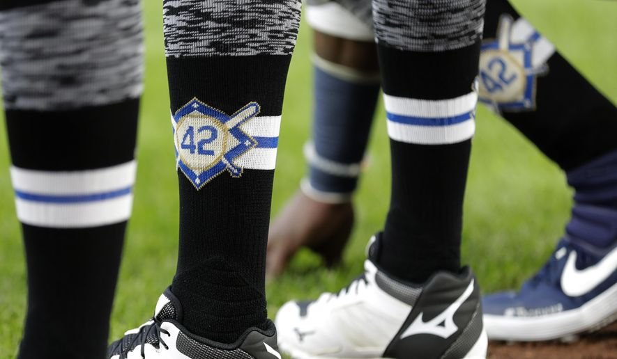 Seattle Mariners players wear No. 42 on their socks in honor of Jackie Robinson Day before a baseball game against the Cleveland Indians, Monday, April 15, 2019, in Seattle. (AP Photo/Ted S. Warren)