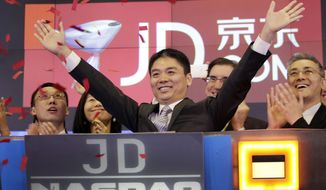 FILE - In this file photo taken May 22, 2014, Liu Qiangdong, also known as Richard Liu, CEO of JD.com, raises his arms to celebrate the IPO for his company at the Nasdaq MarketSite, in New York. A woman who said she was raped by Liu filed a lawsuit Tuesday, April 16, 2019, against the billionaire and his company alleging he and other wealthy Chinese executives coerced her to drink during a dinner in the hours before she was attacked. (AP Photo/Mark Lennihan, File)