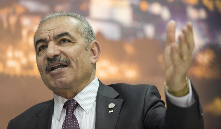 Palestinian Prime Minister Mohammad Shtayyeh italks during an interview with The Associated Press, at his office in the West Bank city of Ramallah, Tuesday, April 16, 2019. (AP Photo/Nasser Nasser)