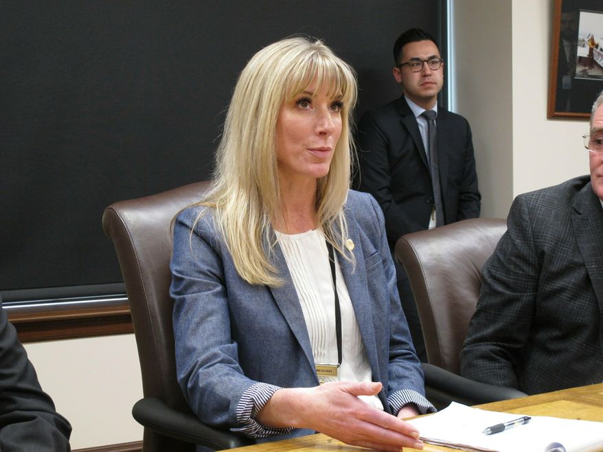 Amanda Price, Gov. Mike Dunleavy's pick to lead the Alaska Department of Public Safety, speaks during a news conference in which she took questions about her nomination on Tuesday, April 16, 2019, in Juneau, Alaska. Price and the Dunleavy administration are defending her nomination ahead of a scheduled vote by lawmakers on Price's confirmation Wednesday. (AP Photo/Becky Bohrer)
