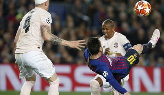 Barcelona forward Lionel Messi tries to score with a bicycle kick during the Champions League quarterfinal, second leg, soccer match between FC Barcelona and Manchester United at the Camp Nou stadium in Barcelona, Spain, Tuesday, April 16, 2019. (AP Photo/Joan Monfort)