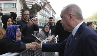 Turkey's President Recep Tayyip Erdogan shakes hands with a supporter as he arrives to speak at an assembly for religious schools, in Istanbul, Saturday, April 13, 2019. Erdogan's ruling party still appealing the results of the local elections in Istanbul, where the opposition has a razor-thin lead and Erdogan said Wednesday election results in Istanbul should be canceled over irregularities.(Presidential Press Service via AP, Pool)