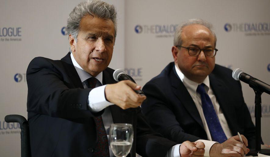 Ecuador's President Lenin Moreno, left, speaks at an event at the Inter-American Dialogue think tank, Tuesday, April 16, 2019, in Washington. (AP Photo/Patrick Semansky)