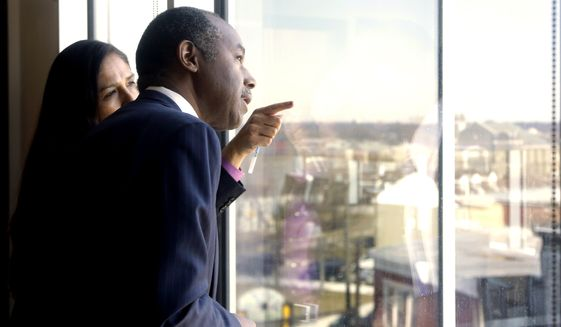 Housing and Urban Development Secretary Ben Carson is shown a view of Philadelphia by Lopa Kolluri, Chief Development and Operating Officer for the Philadelphia Housing Authority (PHA), Thursday, Feb. 14, 2019, in Philadelphia. Carson was in Philadelphia to announce the awarding of $74 million in grants to hundreds of public housing authorities across the country. (AP Photo/Jacqueline Larma) ** FILE **