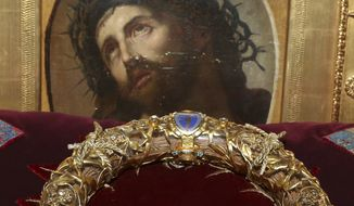 "In this Friday, March 21, 2014, file photo a crown of thorns which was believed to have been worn by Jesus Christ and which was bought by King Louis IX in 1239 is presented at Notre Dame Cathedral in Paris. Paris' mayor, Anne Hidalgo, said a significant collection of art and holy objects inside the church had been recovered from the fire at Notre Dame cathedral. In a tweet later, she thanked firefighters and others who formed a human chain to save artifacts. ""The crown of thorns, the tunic of St. Louis and many other major artifacts are now in a safe place,"" she wrote. (AP Photo/Remy de la Mauviniere, File)"