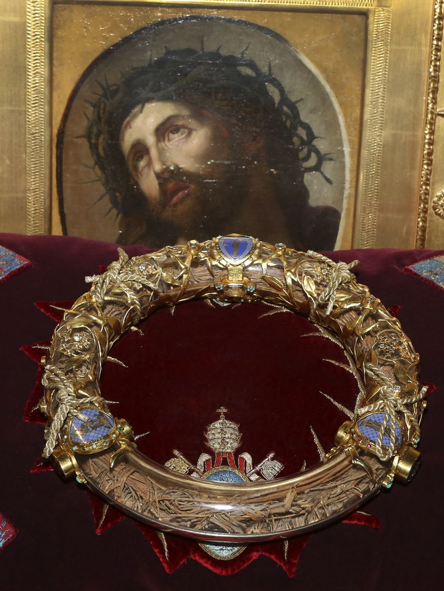 """In this Friday, March 21, 2014, file photo a crown of thorns which was believed to have been worn by Jesus Christ and which was bought by King Louis IX in 1239 is presented at Notre Dame Cathedral in Paris. Paris' mayor, Anne Hidalgo, said a significant collection of art and holy objects inside the church had been recovered from the fire at Notre Dame cathedral. In a tweet later, she thanked firefighters and others who formed a human chain to save artifacts. """"The crown of thorns, the tunic of St. Louis and many other major artifacts are now in a safe place,"""" she wrote. (AP Photo/Remy de la Mauviniere, File)"""