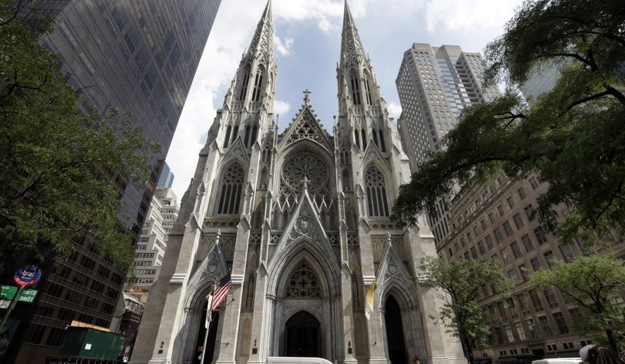 This Sept. 6, 2018, file photo shows St. Patrick's Cathedral in New York. A New Jersey man has been arrested outside the cathedral with two jugs of gasoline. Police say church personnel stopped the 37-year-old man from entering the landmark cathedral in Manhattan at about 9 p.m. Wednesday, April 17, 2019. Authorities were investigating whether the unidentified man is emotionally disturbed. (AP Photo/Richard Drew) ** FILE **