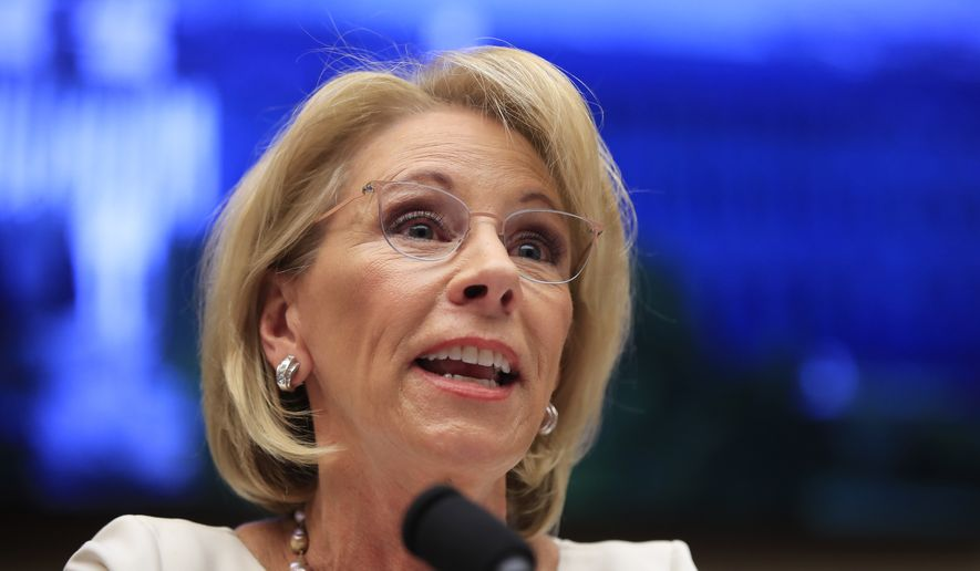 "In this Wednesday, April 10, 2019, file photo, Education Secretary Betsy DeVos testifies before the House Education and Labor Committee at a hearing on ""Examining the Policies and Priorities of the U.S. Department of Education"" on Capitol Hill in Washington. (AP Photo/Manuel Balce Ceneta, File)"
