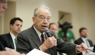 Sen. Chuck Grassley, R-Iowa, asks a question during a field hearing of the Senate Committee on Environment and Public Works, in Glenwood, Iowa, Wednesday, April 17, 2019. The hearing was called to investigate the U.S. Army Corps of Engineers' Management of the 2019 Missouri River Basin Flooding. (AP Photo/Nati Harnik) ** FILE **