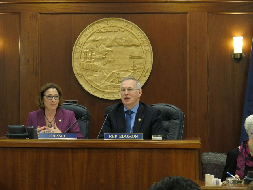 Alaska state Senate President Cathy Giessel, left, and House Speaker Bryce Edgmon are shown before the start of a joint legislative session on Wednesday, April 17, 2019, in Juneau, Alaska. The Legislature met to consider Gov. Mike Dunleavy's picks for Cabinet-level positions and for boards and commissions. (AP Photo/Becky Bohrer)
