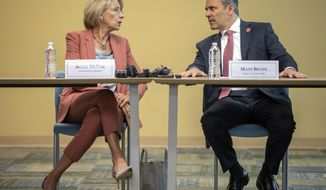 U.S. Secretary of Education Betsy DeVos, left, speaks with Kentucky Gov. Matt Bevin before a roundtable discussion on school choice efforts in the state, Wednesday, April 17, 2019, at Bluegrass Community & Technical College in Lexington, Ky. Bevin is teaming with DeVos to promote school choice initiatives. DeVos touted a Trump administration proposal during the roundtable discussion. (Ryan C. Hermens/Lexington Herald-Leader via AP)