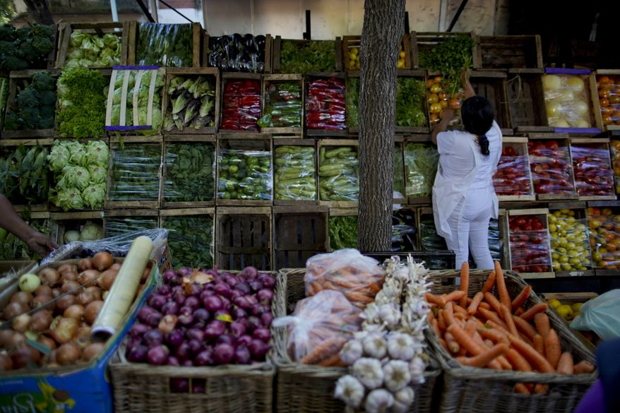 A array of fruits and vegetables are displayed for sale at a street market in Buenos Aires, Argentina, Tuesday, April 16, 2019. Argentina's national statistics official agency announced the inflation figures for March. Despite efforts by President Mauricio Macri's government to tame runaway inflation the monthly metric continues to present troubling results. (AP Photo/Natacha Pisarenko)