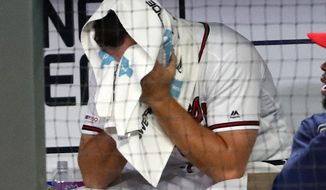 Atlanta Braves relief pitcher Jesse Biddle sits on the bench after walking in the go-ahead run in the 10th inning of the team's baseball game against the Arizona Diamondbacks on Wednesday, April 17, 2019, in Atlanta. Arizona won 3-2. (AP Photo/John Bazemore)