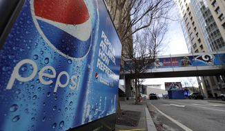 In this Jan. 30, 2019, file photo, an advertisement for Pepsi is shown downtown for the NFL Super Bowl 53 football game in Atlanta. (AP Photo/David J. Phillip, File)