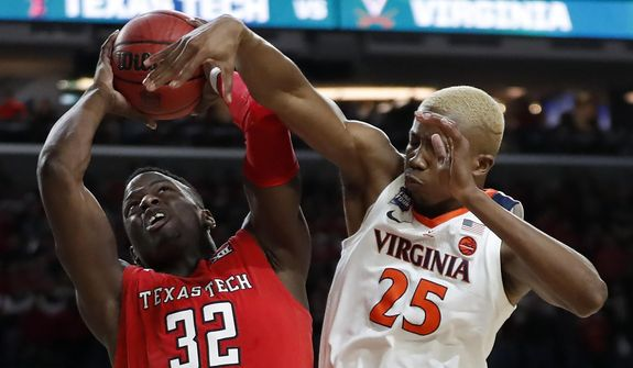 Texas Tech's Norense Odiase (32) shoots against Virginia's Mamadi Diakite (25) during the second half in the championship of the Final Four NCAA college basketball tournament, Monday, April 8, 2019, in Minneapolis. (AP Photo/Jeff Roberson) **FILE**
